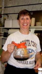 Joan keeps the customers' bottomless cups filled with coffee and their hearts filled with good cheer.